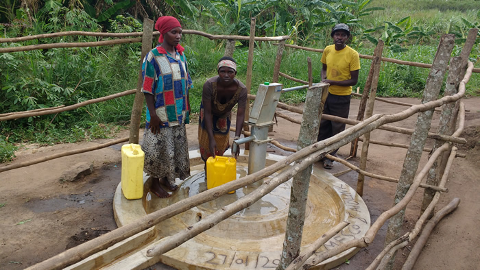 L-R, Ms. Charity Muhabwa (VHT) ,Ms. Grace Businge (water user) & Mr. Geofrey Mucunguzi (care taker) at the Shallow well in Kaiguta.